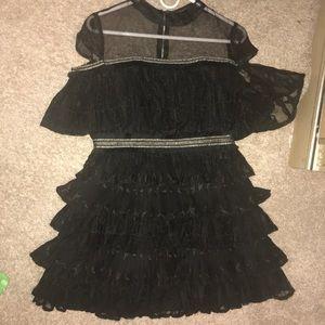 Three tier black and gold dress